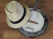 A Samba Banjo (a Brazilian String Musical Instrument) And A Samba Player (sambista) Hat On A Wooden  poster