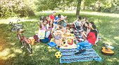 Happy Friends Group Having Fun Outdoor Cheering At Bbq Picnic With Snacks Food Drinking Red Wine - Y poster