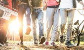 Friends Walking In City Park With Backlight And Sunflare Halo - Millenial Friendship Concept And Mul poster