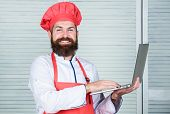 Grocery Shop Online. Delivery Service. Chef Laptop At Kitchen. Culinary School. Hipster In Hat And A poster