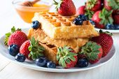 Fresh Homemade Food Of Berry Belgian Waffles With Honey, Chocolate, Strawberry, Blueberry, Maple Syr poster