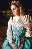 Beautiful Woman In Vintage Blue Dress With Fan In Crown Diadem. Elegant Lady poster