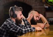 Friday Relaxation In Bar. Hipster Bearded Man Spend Leisure At Bar Counter. Order Drinks At Bar Coun poster