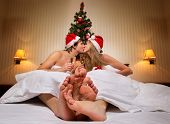 pic of bow-legged  - Young couple in Santa - JPG