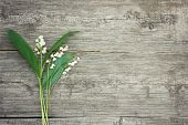 Bouquet Of Lilies Of The Valley On A Wooden Background. Beautiful Floral Frame With Lilies Of The Va poster