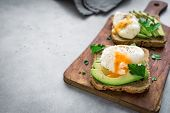 Poached Eggs And Avocado Sandwiches poster