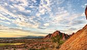 stock photo of chola  - Beautiful desert landscape with red rock buttes and gorgeous summer glowing sky wit little fluffy clouds - JPG