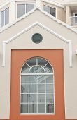 foto of palladium  - A palladium window on an orange and gray stucco wall - JPG