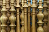 stock photo of bannister  - assemblage of curvy staircase balusters waiting for shipment - JPG