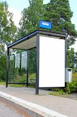 foto of bus-shelter  - Urban bus stop shelter wth single blank billboard for your advertisement - JPG