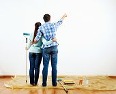 picture of wall painting  - renovation diy paint couple in new home painting wall - JPG