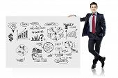 foto of interior sketch  - businessman in suit and business plan on white board - JPG