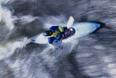 Overhead view of a kayaker paddling through rapids