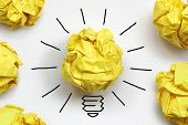 picture of sketche  - Inspiration concept crumpled paper light bulb metaphor for good idea - JPG