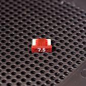 picture of fuse-box  - Mini automotive fuse on open fuse box panel - JPG