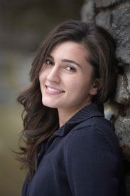 stock photo of beautiful young woman  - Beautiful smiling young woman outdoor portrait headshot - JPG