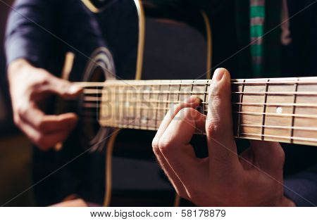 Man Playing Music At Black Wooden Acoustic Guitar poster