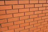 stock photo of oblique  - Oblique view of textured background in a red brick wall - JPG