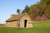 stock photo of revolutionary war  - A reproduction of cabins used by Revolutionary War soldiers during the winter of 1777 - JPG