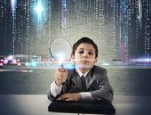 picture of maliciousness  - Young boy looking for malicious code of a virus - JPG