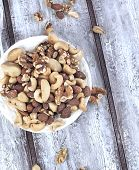 stock photo of pine nut  - Nuts Word From Different Nuts - JPG