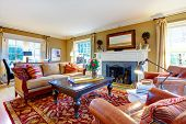 pic of stone house  - Cozy family room with light tone walls old - JPG