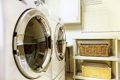 image of laundry  - Old style laundry room with modern appliances and wicker baskets - JPG