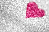 foto of confetti  - An abstract silver glitter and heart background