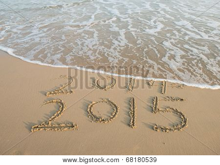 new year 2015 written in sand poster