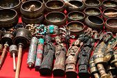 picture of chalice antique  - Bunch of tibetan traditional souvenirs lying on red table  - JPG