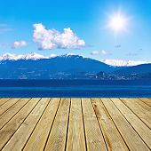 foto of lagos  - Beautiful view from wooden terrace to the Alps mountains at Lago Maggiore Italy - JPG
