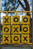 stock photo of nac  - Naughts and crosses game in a children playground - JPG