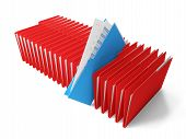 image of blinders  - Row of red binders of documents with a blue coming out - JPG