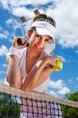image of youg  - Youg pretty girl playing tennis on cort - JPG