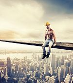 stock photo of mason  - Sexy mason at work over modern cityscape - JPG