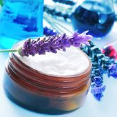 picture of flask  - a cream jar and some lavender flowers and flasks in a cosmetics laboratory - JPG