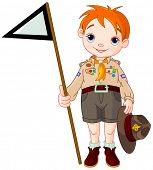 image of boy scout  - Young  happy boy scout  holding a flag - JPG