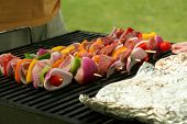 foto of barbecue grill  - Pork souvlaki skewers on a barbecue grill - JPG