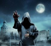 stock photo of rosary  - Medieval monk at night - JPG