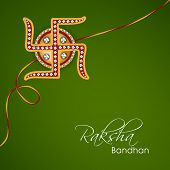 image of swastik  - Beautiful rakhi decorated with Swastik on green background for Happy Raksha Bandhan celebrations - JPG