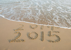 image of pass-time  - new year 2015 written in sand - JPG