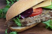 stock photo of cheese-steak  - Sandwich with pork steak tomato cheese and lettuce. ** Note: Shallow depth of field - JPG