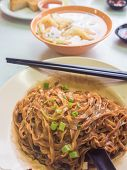stock photo of malaysian food  - �Mee� Malaysian noodle. Simple fried with fish ball soup. - JPG