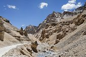 stock photo of manali-leh road  - Mountain Road And River on the way from Manali to Leh in Indian Himalaya - JPG
