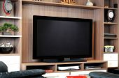 stock photo of shelving unit  - A large flat screen TV in shelving unit in lounge - JPG