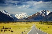 picture of mountain-range  - Landscape with road and snowy mountains Southern Alps New Zealand - JPG