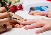 stock photo of uv-light  - manicure and Hands with uv lamp for nails - JPG