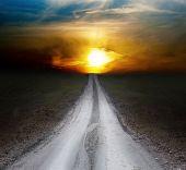 image of dirt road  - small rural dirt road leading towards dawn - JPG