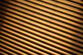 stock photo of jalousie  - Closed brown metal jalousie background in closeup - JPG