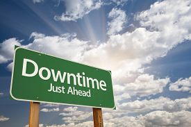 stock photo of sabbatical  - Downtime Just Ahead Green Road Sign with Dramatic Clouds and Sky - JPG